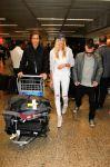Celebrities Wonder 65411906_Candice-Swanepoel-airport_3.jpg