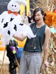 Celebrities Wonder 56821650_milla-jovovich-Mr-Bones-Pumpkin-Patch_7.jpg