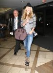 Celebrities Wonder 92939910_Rosie-Huntington-Whiteley-LAX-airport_4.jpg