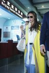 Celebrities Wonder 93959401_victoria-beckham-airport_3.jpg
