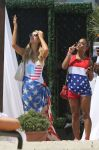 Celebrities Wonder 86914662_Paris-Hilton-and-Christina-Milian-beach_4.jpg