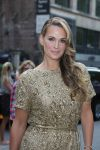 Celebrities Wonder 67218526_marchesa-spring-2014-front-row_Molly Sims 2.jpg