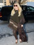 Celebrities Wonder 13604362_Jessica-Simpson-wearing-a-poncho_3.jpg