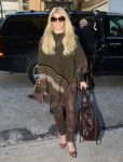 Celebrities Wonder 18617843_Jessica-Simpson-wearing-a-poncho_1.jpg