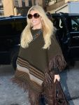 Celebrities Wonder 19550448_Jessica-Simpson-wearing-a-poncho_5.jpg