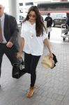Celebrities Wonder 92612779_freida-pinto-lax-airport_1.jpg