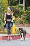Celebrities Wonder 99631648_miley-cyrus-walking-dog_2.jpg