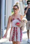Celebrities Wonder 90404365_ashley-tisdale-with-her-dog_4.jpg