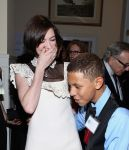Celebrities Wonder 65653650_anne-hathaway-2014-World-Of-Children-Awards_4.jpg