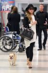 Celebrities Wonder 56170643_chrissy-teigen-jfk-airport_1.jpg