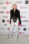 Celebrities Wonder 97747432_elton-john-oscar-party_Miley Cyrus.jpg